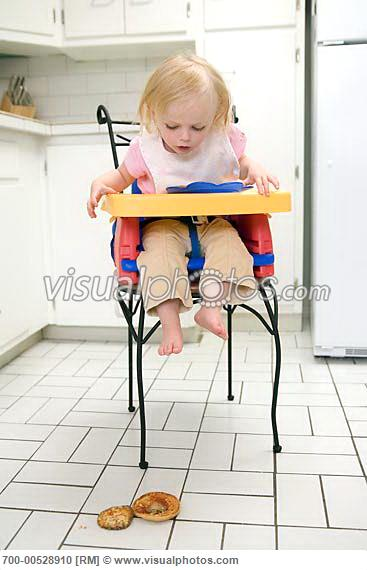 child_in_high_chair_dropping_food_700-00528910.jpg